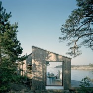 The Kråkmora Holmar House functions as a guest house for a home 25 feet uphill.