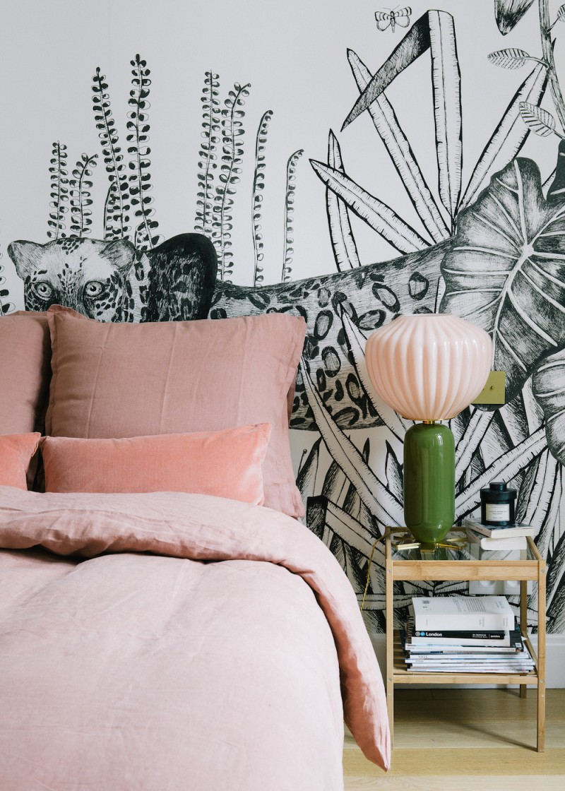 Morgane Sézalory, Paris apartment. Bedding Sézane. Palm wallpaper Bien Fait. Pink lamp India Mahdavi.