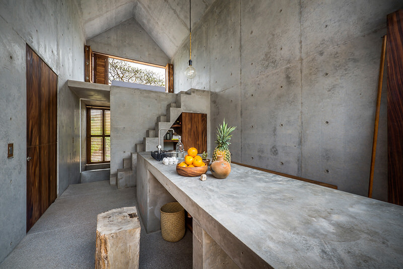 Interior casa tiny with concrete table kitchen