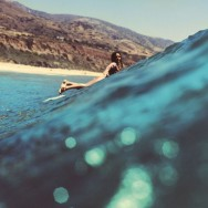 surfer-on-leo-carrillo-beach-malibu-california