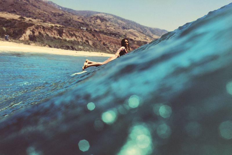 surfer-on-leo-carrillo-beach-malibu-california