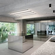 """Mirrored walls reflect the exposed concrete."""