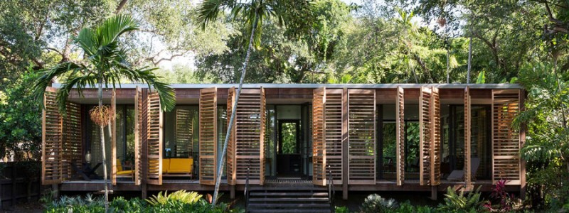 Wooden shutters wrap around this Miami home.