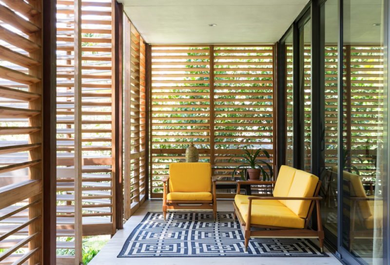 Inside, Brillhart Architects has contrasted the house's glass walls with various types of wood, including reclaimed cherry, oak and red cypress.